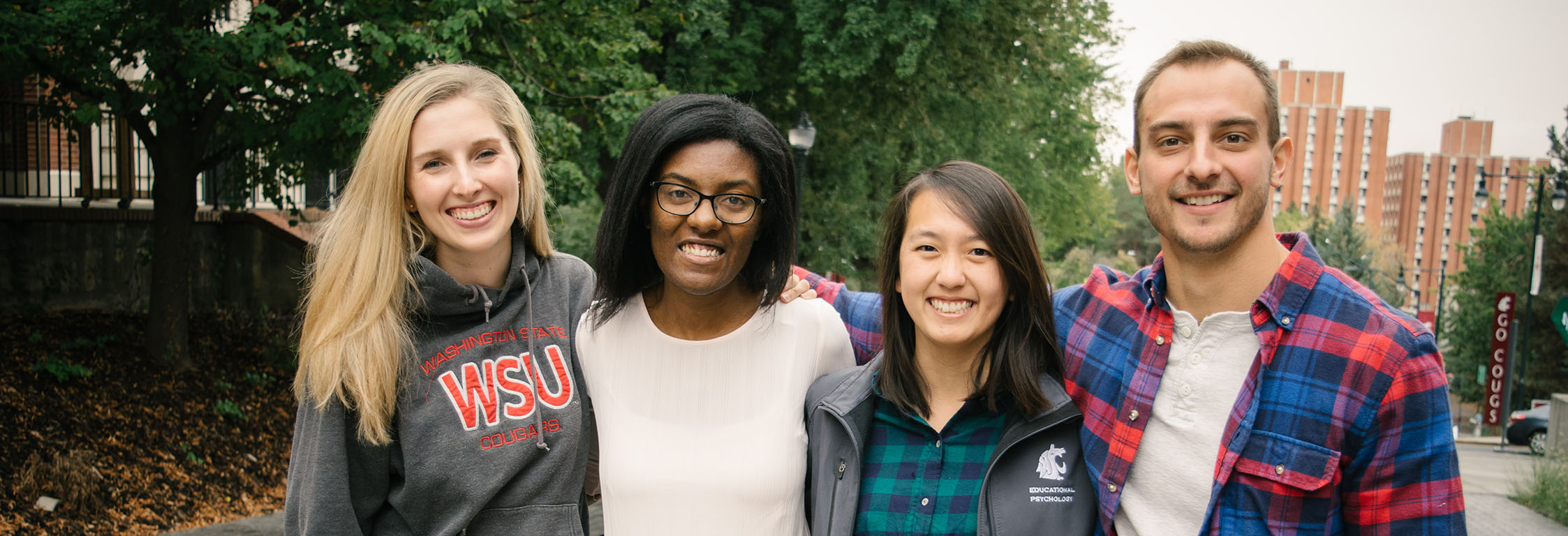 Four students smile for a photo on the WSU Pullman campus.